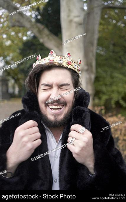 happy man wearing crown