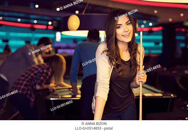 Portrait of smiling woman in billiard club. Rzeszow, Poland