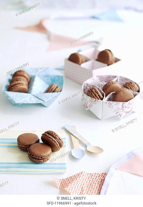 chocolate macaroons in various types of gift packaging