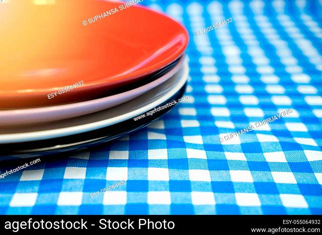 Stack ceramic plate or dish on table