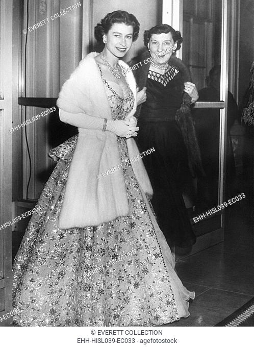 Queen Elizabeth II and Mamie Eisenhower in evening gowns at the British Embassy. Oct. 19, 1957. - (BSLOC-2014-16-216)