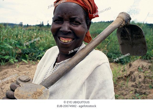 Portrait of woman with hoe, a member of the Women's Agricultural Association reformed after the genocide