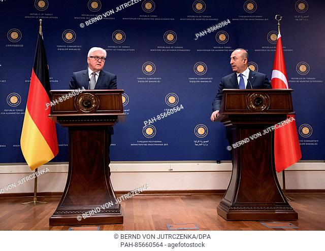 The German foreign minister Frank-Walter Steinmeier (L) with his Turkish opposite Mevlut Cavusoglu at a press conference after concluding talks in Ankara