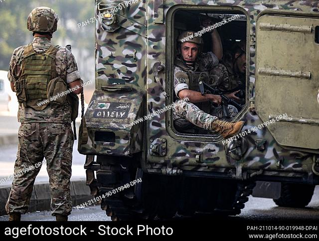 14 October 2021, Lebanon, Beirut: Lebanese army deployed in the area of in the area of Tayouneh, after gunfire erupted at a protest by supporters of the Shiite...