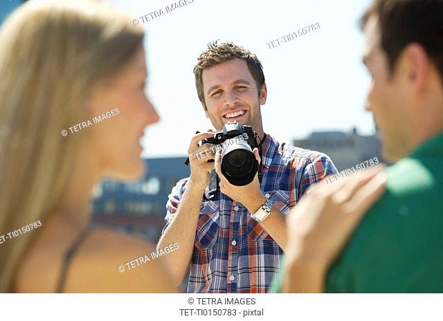 Photographer taking picture of couple
