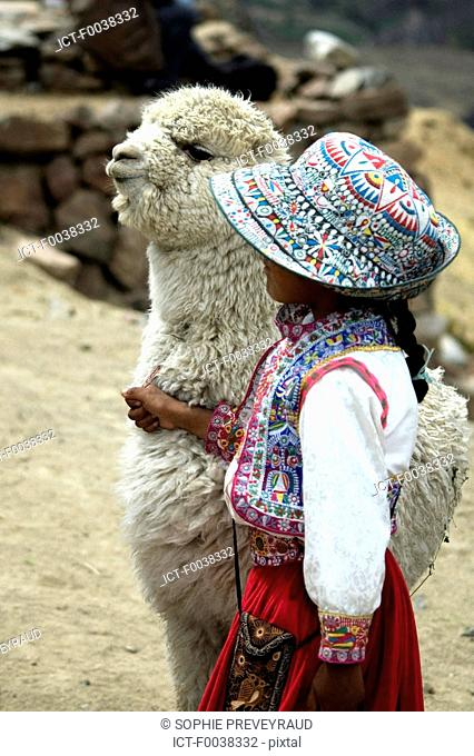 Peru, Colca canyon, child and vicuna