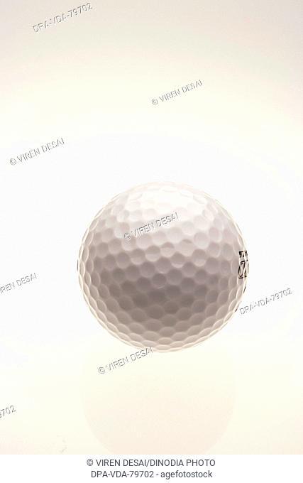 Golf ball against white background