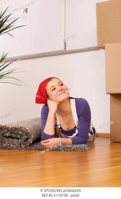 young woman moving in new home house smiling