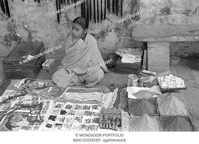 A young street vendor displaying her goods on the street. Varanasi, 1965
