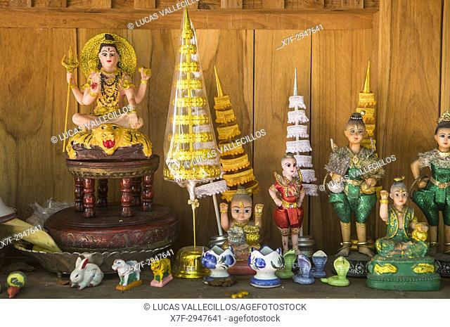 Dolls given as offerings, in Wat Phra Singh temple, Chiang Mai, Thailand