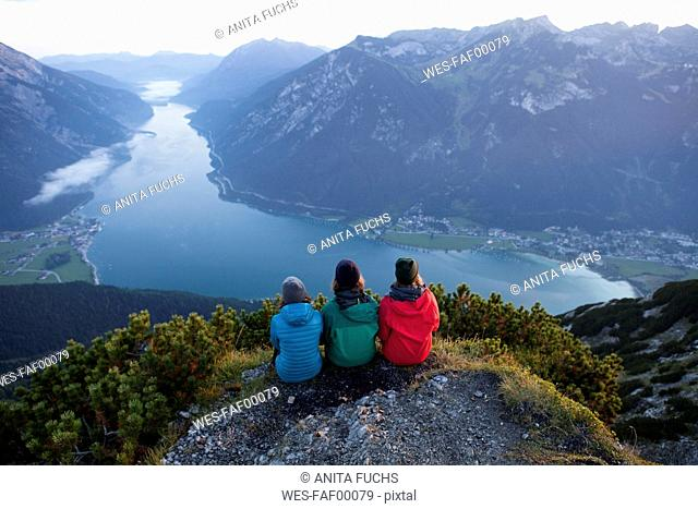 Austria, Tyrol, three hikers enjoying the view on Achensee