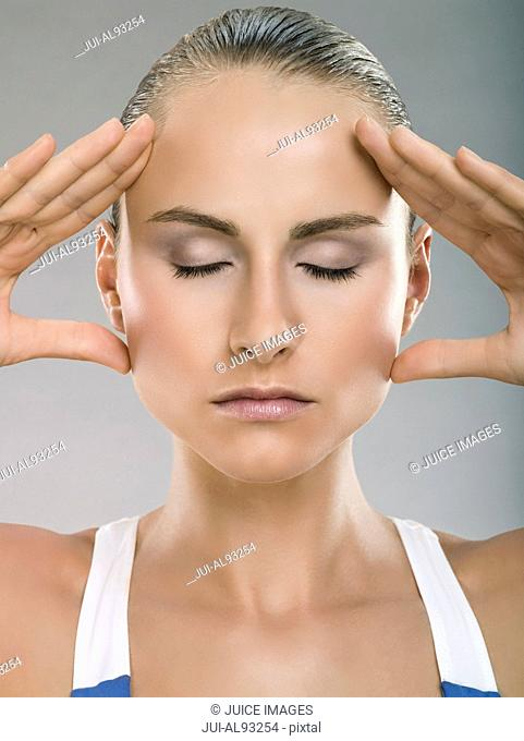 Woman with hands on side of face