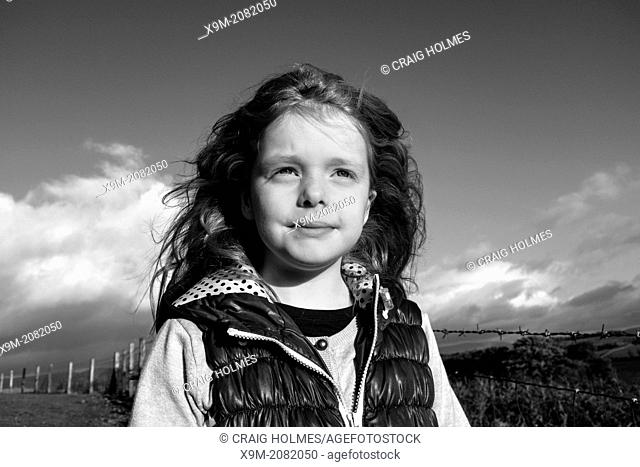Portrait of a girl in the countryside