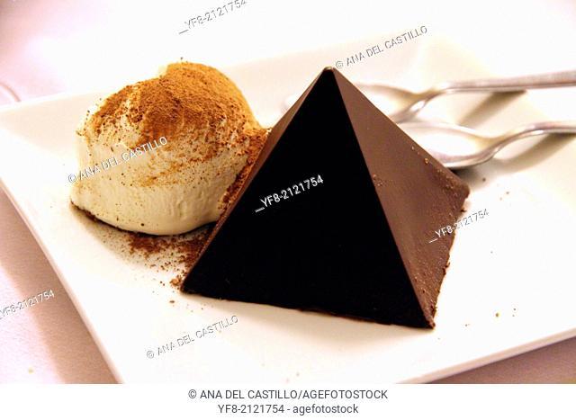 chocolate pyramid dessert with ice cream