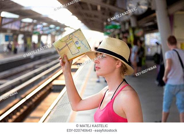 Young woman on platform of railway station
