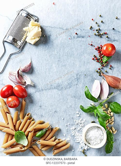 An arrangement of assorted ingredients for pasta dishes (from above)