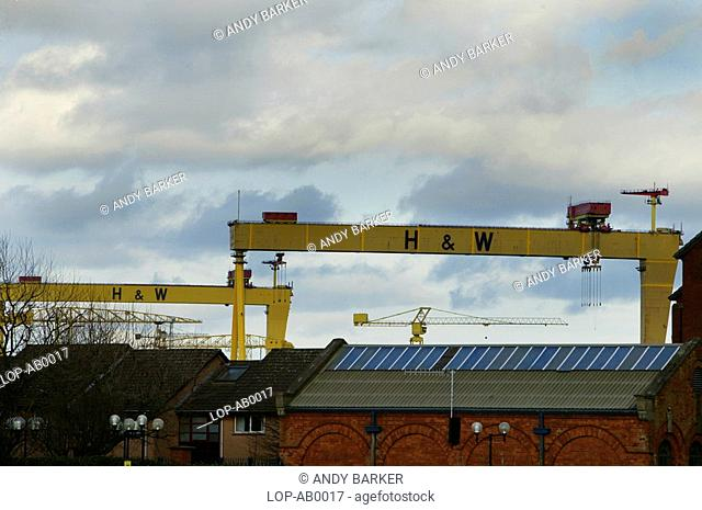 Northern Ireland, Belfast, Titanic Quarter, A view over building tops to the cranes in the Titanic Quarter of Belfast harbour
