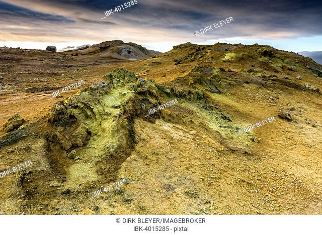 Solfataras, fumaroles, mud pots, mud pools, sulfur and other minerals, on the summit of the mountain Námafjall, high temperature geothermal area or Hverarönd or...