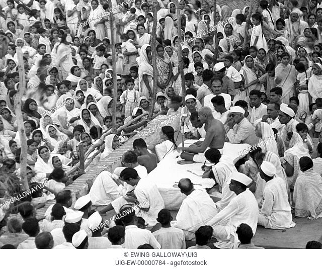 Gandhi speaking in front of large crowd
