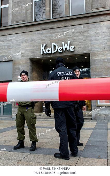 Policemen stand in front of the store KaDeWe behind a barrier in Berlin, Germany, 20 December 2014. So far unknown culprits burgled into the house and robbed a...