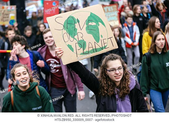 (190228) -- BRUSSELS, Feb. 28, 2019 (Xinhua) -- Students hold placards as they attend a climate march in Brussels, Belgium, on Feb. 28, 2019