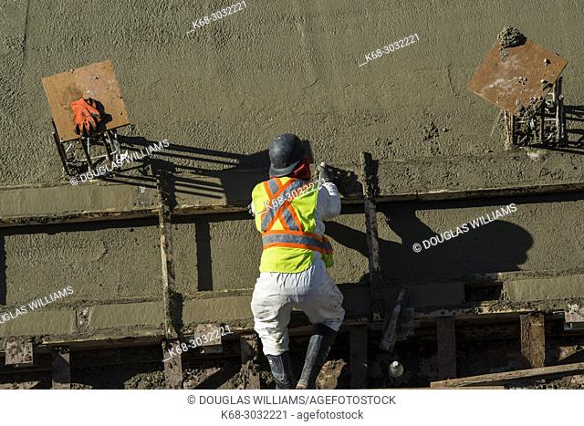 A construction worker at Vancouver House, a tower under construction in Vancouver, BC, Canada