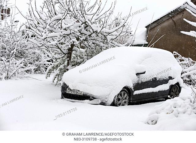 A car is covered with snow at Builth Wells, Powys, Wales, UK