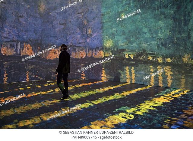 A man walks in front of a video projection in the exhibition 'Monet 2 Klimt' in Dresden, Germany, 14 March 2017. The exhibition which is scheduled to run from...