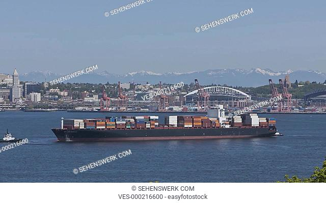 SEATTLE, USA - MAY 12: Timelapse of a cargo freighter in the harbor bay front of the Seattle Harbor on May 12th 2012 in Seattle, USA