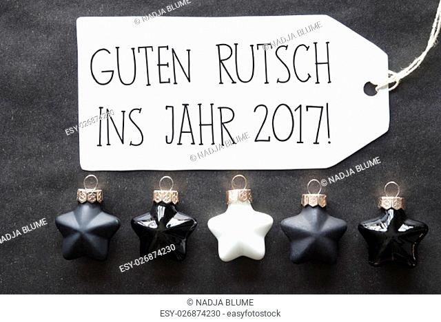 Label With German Text Guten Rutsch Ins Jahr 2017 Means Happy New Year 2017. Black And White Christmas Tree Balls On Black Paper Background