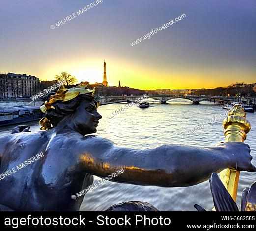 Alexander Bridge with a view of the Seine, Eifell Tower and detail of a decoration, Paris, France, Europe, sunrice