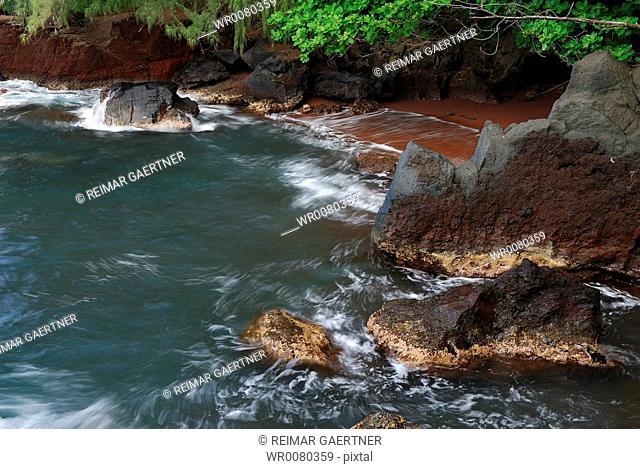 Red sand pocket beach at Kauiki Hill in Hana Maui