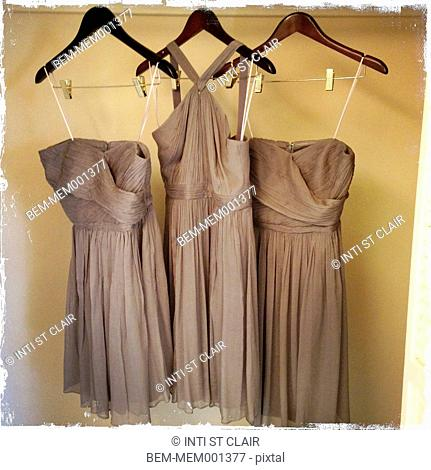 Grey dresses hanging in closet