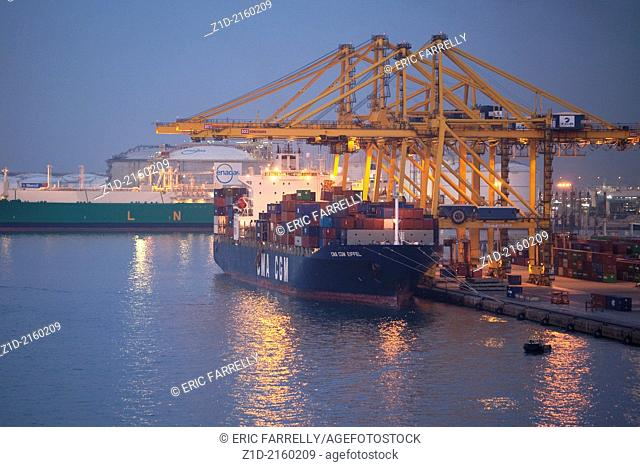 Very early morning at Barcelona Harbour.Container ship discharging cargo.Spain