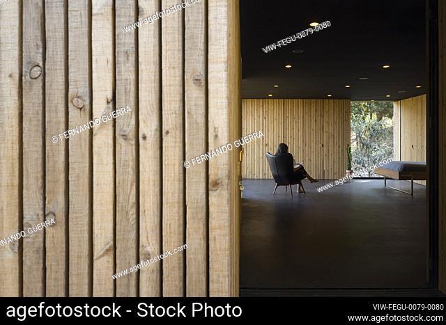 View towards central space with figure. Pavilion House, Guimarães, Portugal. Architect: Diogo Aguiar Studio, 2019