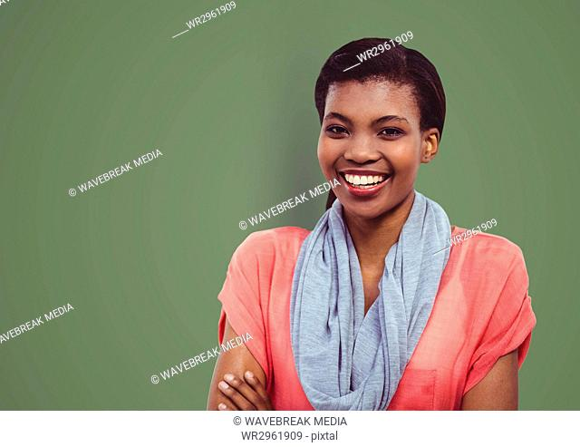 Portrait of happy female hipster standing against green background