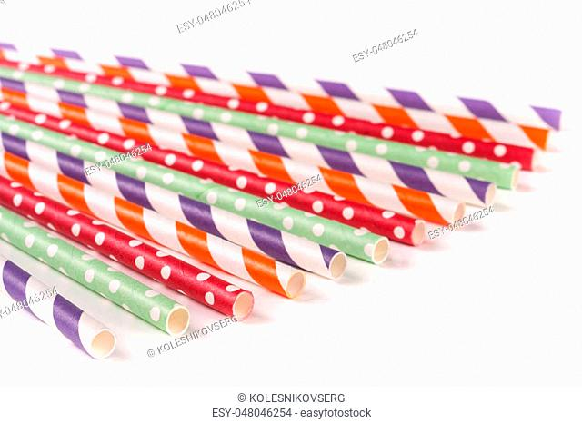 Colorful drinking striped straws isolated on white background