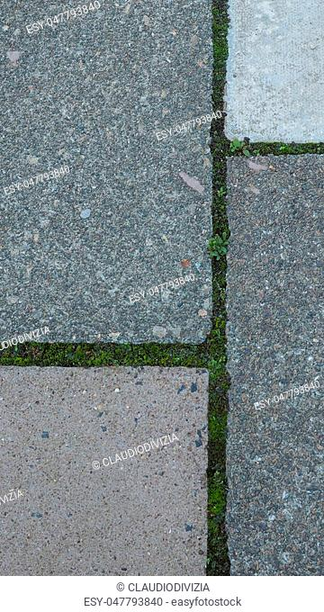 Grey concrete pavement tiles useful as a background - vertical