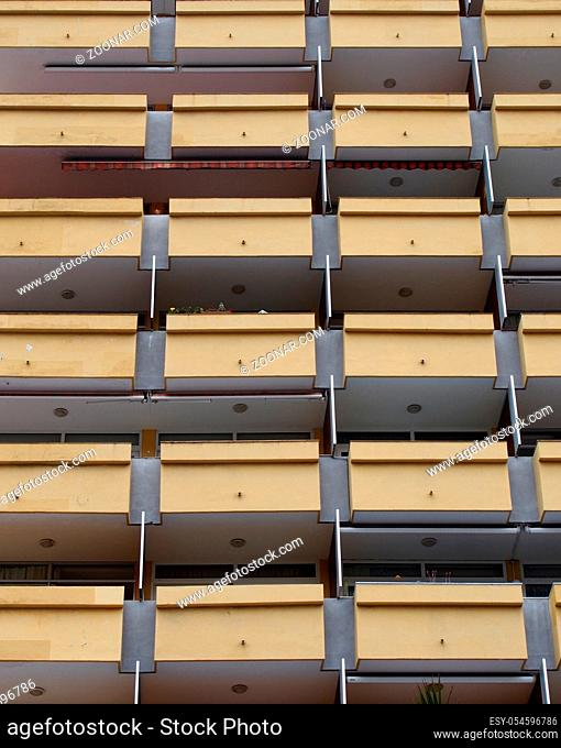 yellow balconies in a modern highrise apartment block or holiday apartments