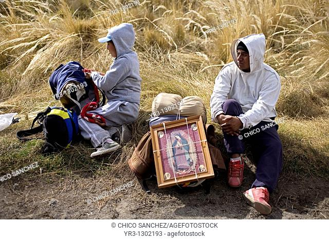 Pilgrims rest in a field as they travel to reach the Basilica of Guadalupe in Mexico City, December 7, 2008  Hundreds of thousands of Mexican pilgrims converged...