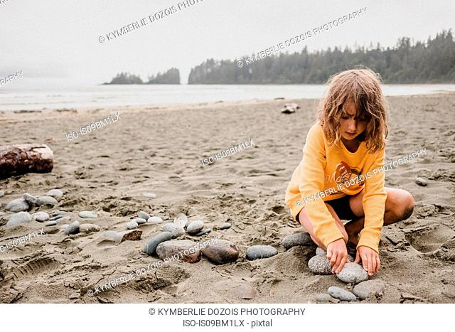 Girl playing on beach, Tofino, Canada
