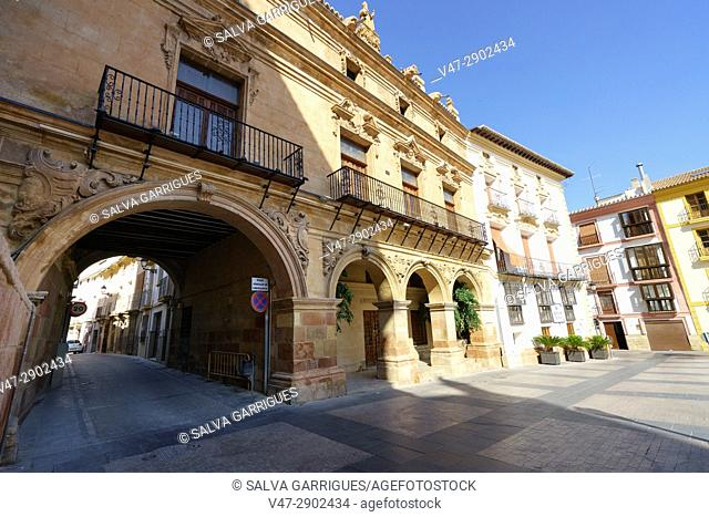 Capitular Rooms of the Collegiate Church of San Patricio through the columns of the portico of the town hall of Lorca, Murcia, Spain