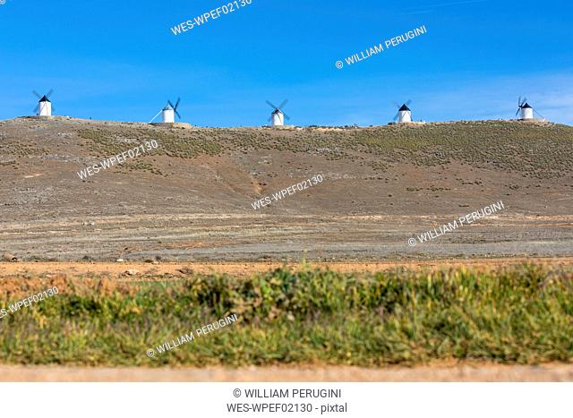 Spain, Province of Toledo, Consuegra, Row of old windmills standing on top of hill