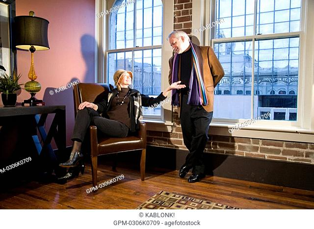 Portrait of mature couple relaxing in modern downtown loft