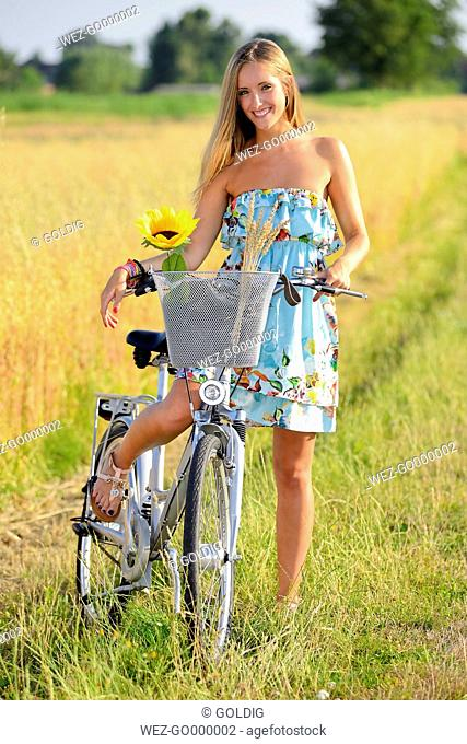 Young woman on bicycle tour in summer
