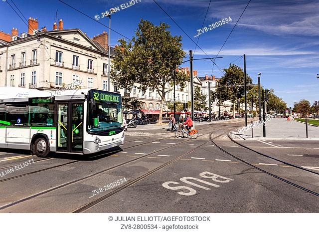 A bus passes through tram system in the city of Nantes in France