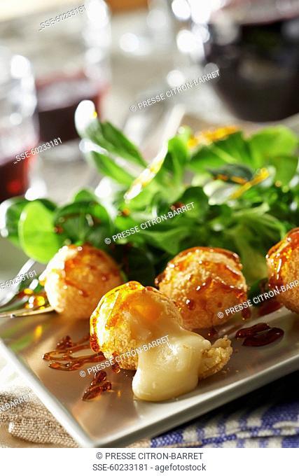 Curé nantais breaded croquettes with acacia honey caramel and corn lettuce salad