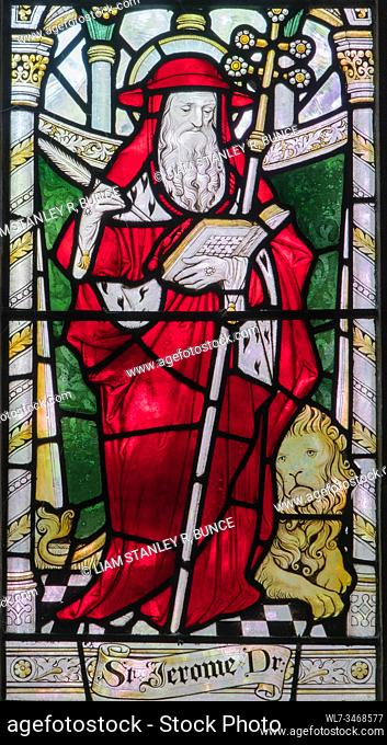 Stained glass depicting St Jerome a Latin Priest, Chester Cathedral Cheshire UK. May 2019
