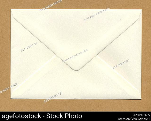 a letter envelope for mail postage shipping over brown paper
