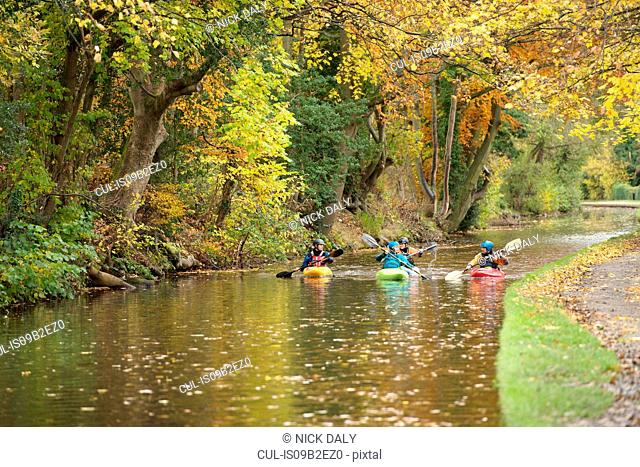 Four kayakers paddling on River Dee, Llangollen, North Wales